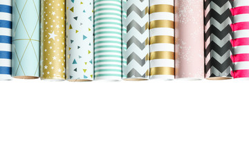 Rolls of festive wrapping paper on white background. Space for text