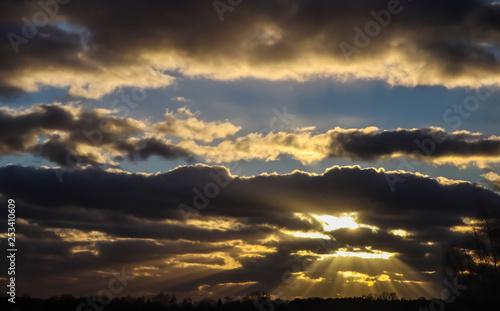 Fototapeta Blue sky and dark clouds with sunlight obraz na płótnie