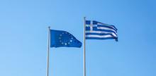 Greece And EU. Greek And European Union Flags Waving On Clear Blue Sky