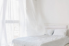 Abstract White Bedroom Interior. Total White Bedroom With Window With Flying Curtains. Morning Breeze Concept