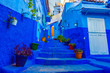 Leinwanddruck Bild - Blue stairs of Chefchaouen, morocco