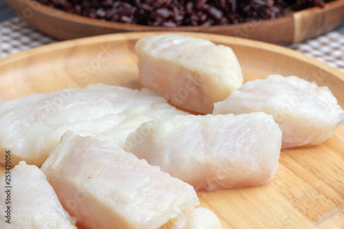 steamed pangasius dory and riceberry rice on wooden plate Canvas Print