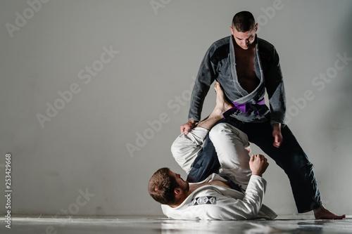 Brazilain Jiu JItsu BJJ Fighters in training sparing open x guard Wallpaper Mural