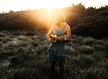 Man Playing Guitar In Nature A...