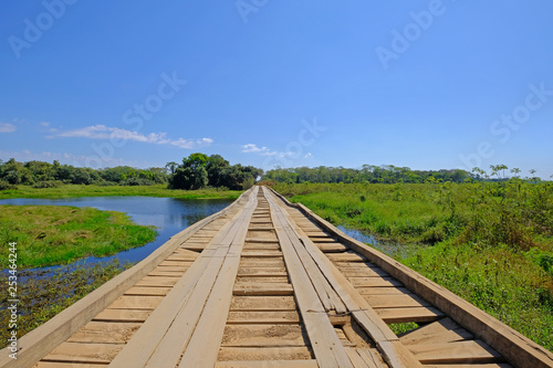 Fotografija  Old damaged wooden bridge on the transpantaneira dirt road with Pantanal wetland