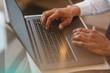Laptop computer - closeup of man browsing internet