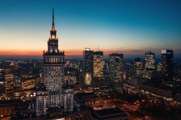 Aerial view of the business center of Warsaw: Palace of Science and Culture and skyscrapers in the evening