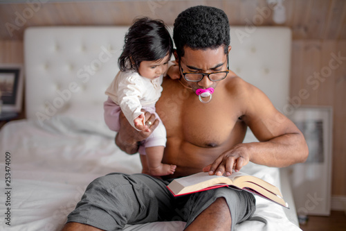 pleasant daddy reading poems to his kid before sleeping, close up photo, Canvas Print