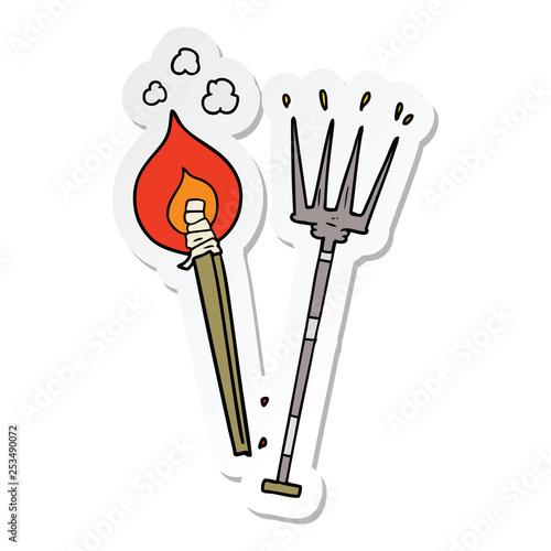 Valokuva sticker of a cartoon pitchfork and burning brand