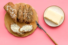 Slice Of Bread With Butter On Pink Background Top View