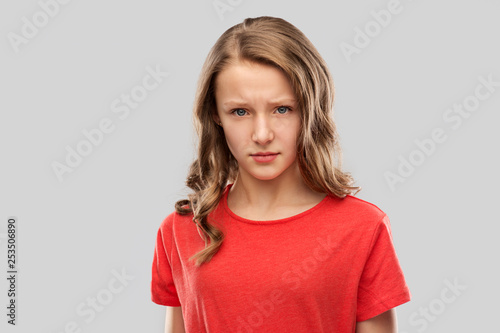 Valokuva  emotion, expression and people concept - sad or angry teenage girl in red t-shir