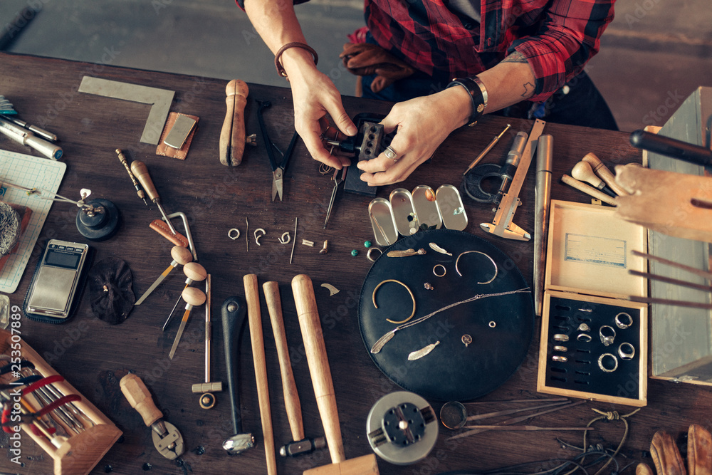 Fototapety, obrazy: guy is sitting at messy desk in the workshop, top view cropped photo