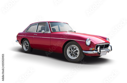 Red British sport classic car isolated on white