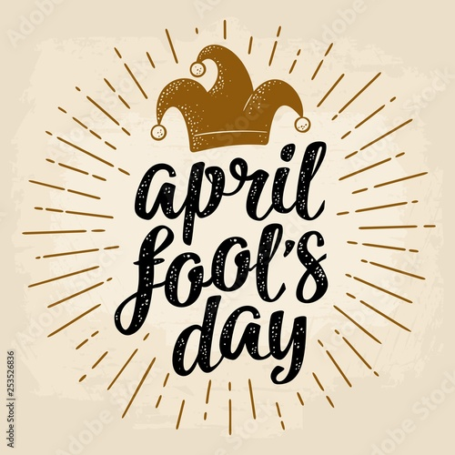 April fool's day calligraphic handwriting lettering with jester cap engraving Fototapeta