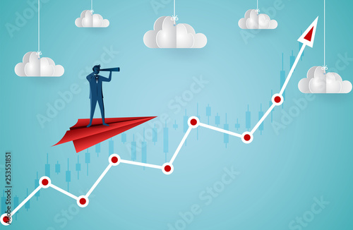 Fotografía  One Businessman standing holding binoculars on a paper plane flying up into the sky while flying above a arrow graph