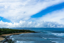 Maui Beach With Rolling Waves And Cloudy Sky.
