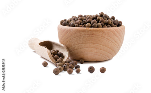 Obraz allspice  in wooden bowl and scoop isolated on white background. Spices and food ingredients. - fototapety do salonu