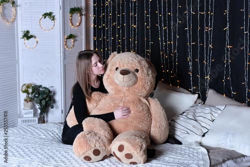 Photo portrait of a girl with teddy bear