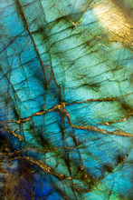 Extreme Close Up Of An Iridescent Blue Labradorite Stone
