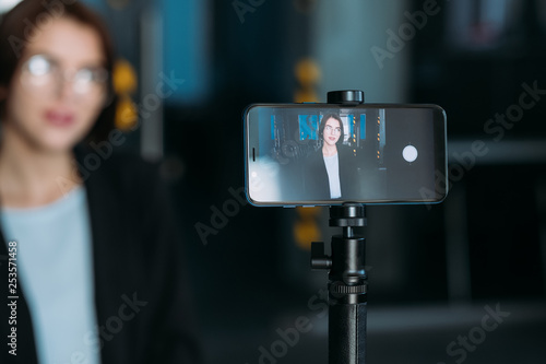 Business master class. Woman coach on webinar. Video tutorial shooting.