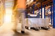 Motion blur man working in warehouse.