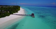 Panoramic Aerial Orbit Around Lone Dock Alongside Maldives Coast With Beautiful White Beach On Crystal Clear Water.