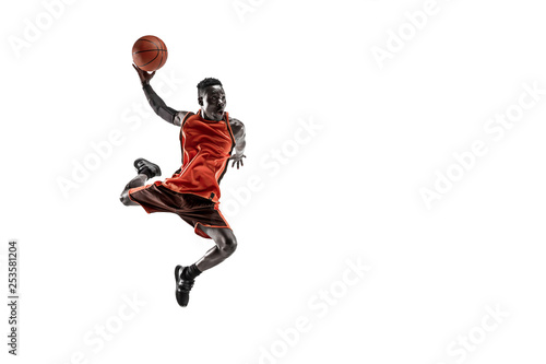Photo  Full length portrait of a basketball player with a ball isolated on white studio background