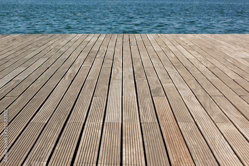 Fototapeta simple background pattern concept surface of wooden deck floor perspective photography with view on swimming pool blue water , copy space obraz na płótnie