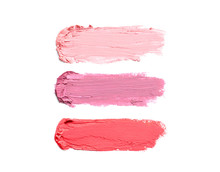 Strokes Of Lipstick On White Background, Top View