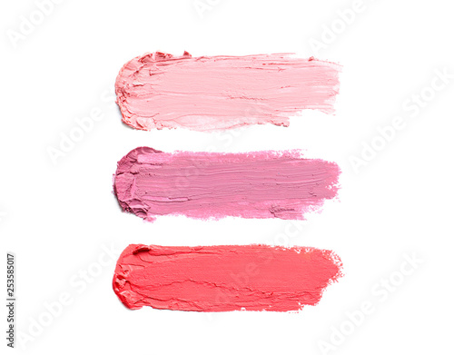 Fotografiet  Strokes of lipstick on white background, top view