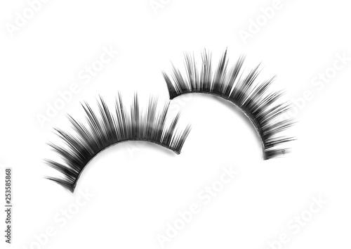 Obraz na płótnie Beautiful pair of false eyelashes on white background, top view
