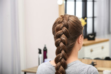 Woman With Braided Hair In Professional Salon
