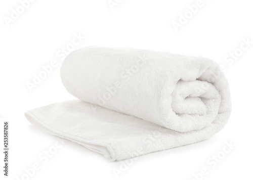 Vászonkép Rolled soft terry towel on white background