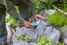 Man With Geologic Compass