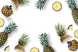 Frame made of pineapple and berries on a white background. Flat lay, top view, copy space. Minimum summer concept.
