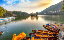 Scenic Bhimtal Lake At Sunset With Wooden Tourist Boats At Nainital Uttarakhand India.