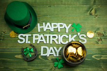 Happy St Patricks Day Wooden Latters With Shamrocks Leprachaun Hat On Wooden Background