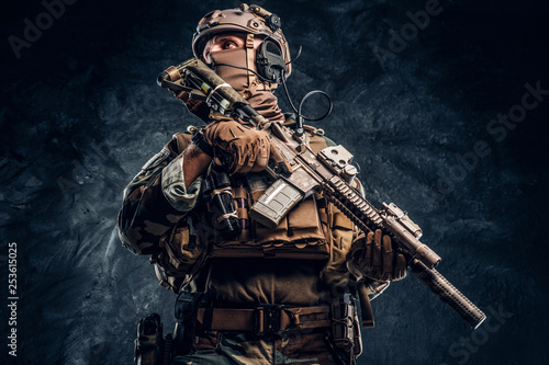 Valokuva  Elite unit, special forces soldier in camouflage uniform posing with assault rifle