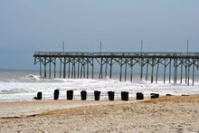 Pier On A Beach With Breaking Waves