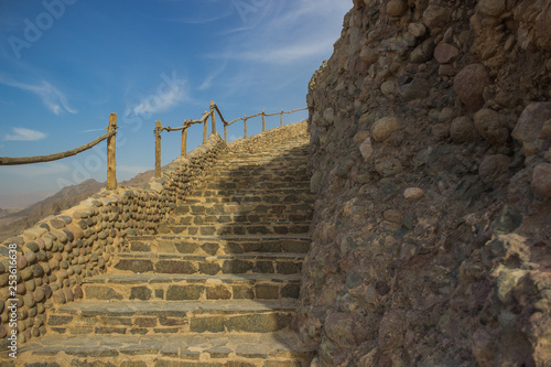 Fotografie, Obraz  up stairway path way carved in rock stone for climbing step by step on top of de