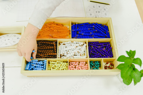 Photo Golden beads materials used to dynamic addition in the Montessori method