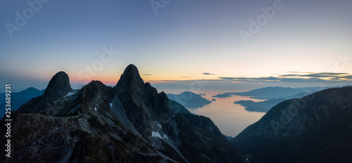 Valokuva  Aerial panoramic view of the Beautiful Canadian Mountain Landscape during a sunny summer sunset