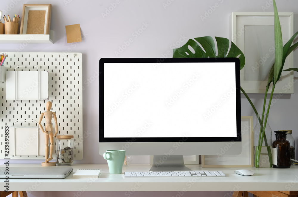 Fototapety, obrazy: Mock up computer on loft workspace table showing blank white screen