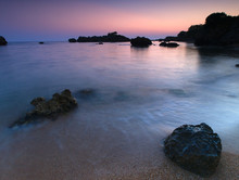 Beautiful Sandy Beach With Rocks In The Sea At Dusk Time, Blue Hour, Stoupa, Peloponnese, Greece.