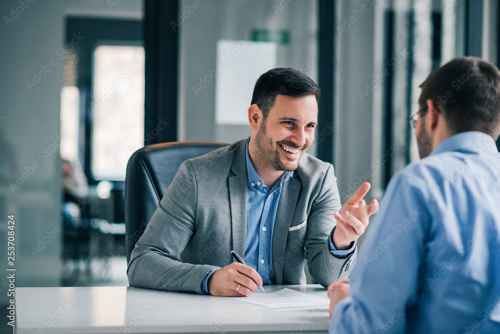 Obraz Man having a business meeting and signing a contract, recruitment or agreement. fototapeta, plakat