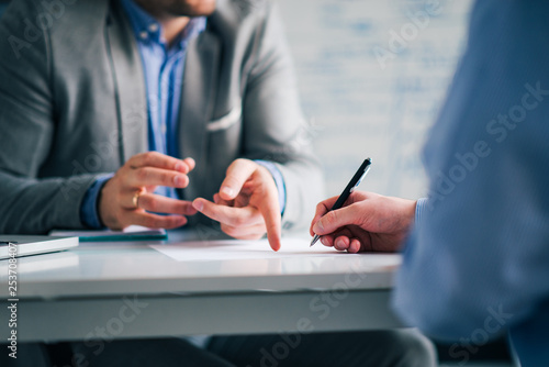Business consultant and customer on a meeting in the office, signing contract Canvas Print