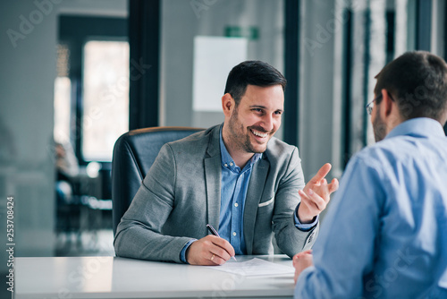 Fototapeta  Man having a business meeting and signing a contract, recruitment or agreement