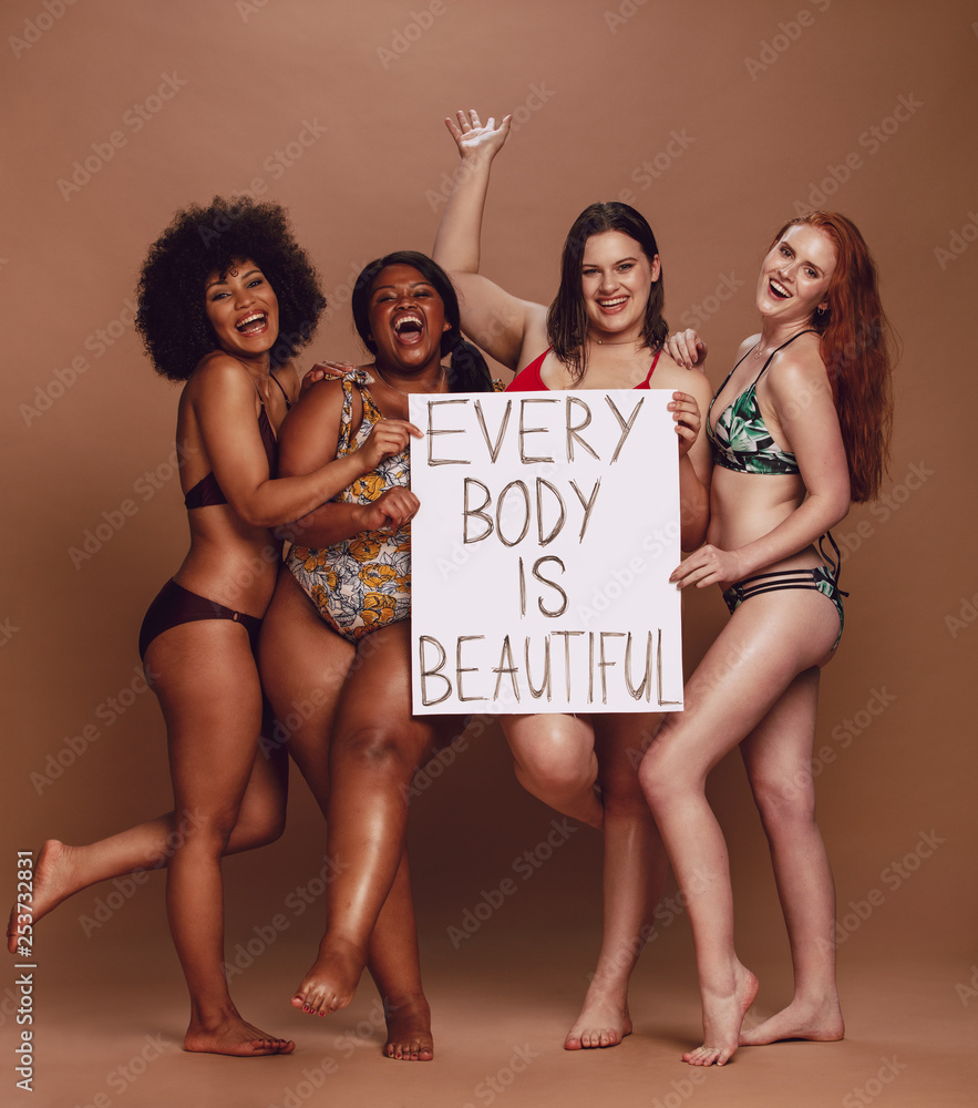 Fototapeta Cheerful female group with every body is beautiful signboard