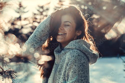 Fototapeta  Woman enjoys a winter sunny day
