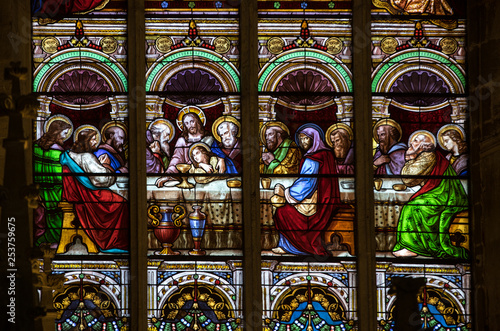 Fotografie, Obraz  Last Supper -  Stained glass window at the Collegiale church of Saint Emilion,